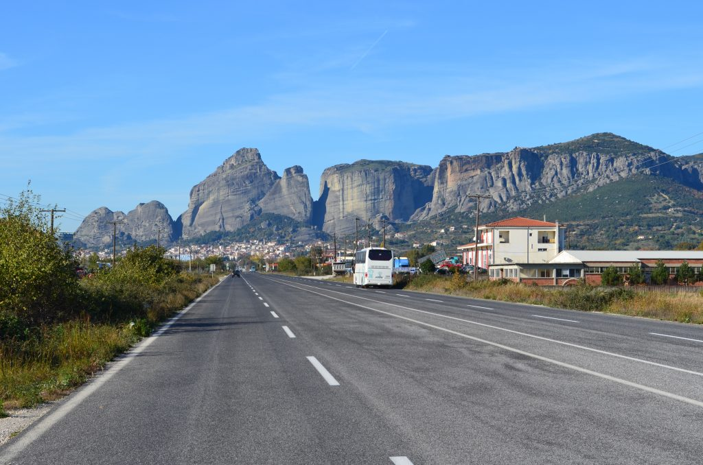 A road with a mountain in the background  Description automatically generated