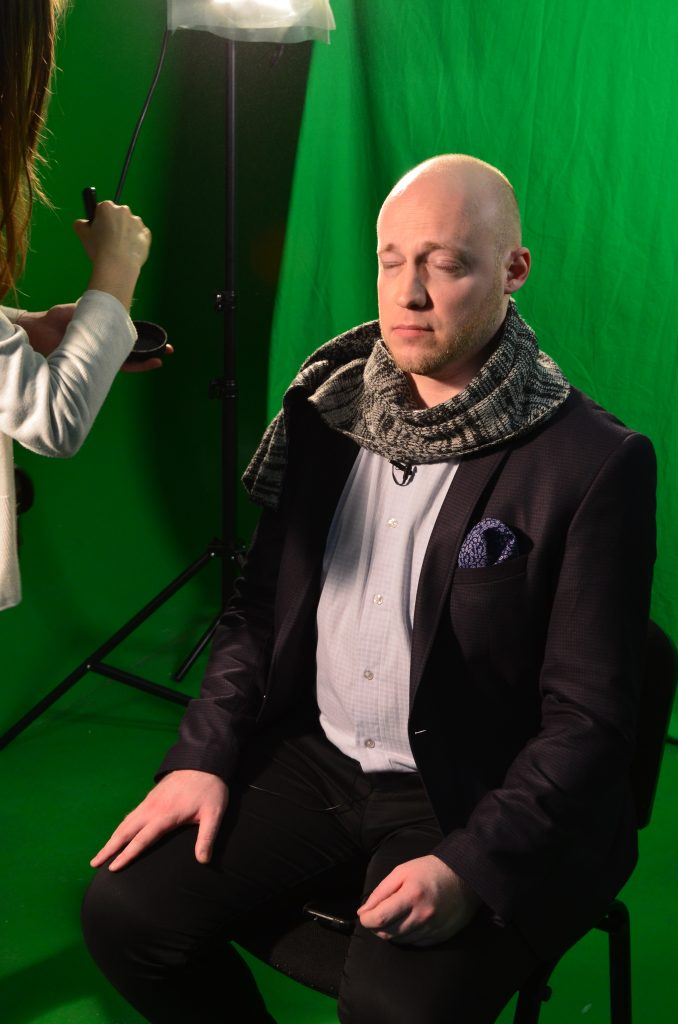 Text Box: Green screening with Pastor Derek who is being given make-up